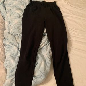 black stretchy dress pants with pockets